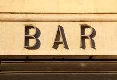 Sign of BAR in big letters on the wall of the building Royalty Free Stock Image