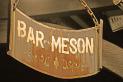 Sign of bar tavern of iron rusty and hung with chains 8 Royalty Free Stock Photography