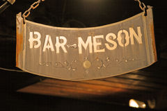 Sign of bar tavern of iron rusty and hung with chains 2 Royalty Free Stock Image