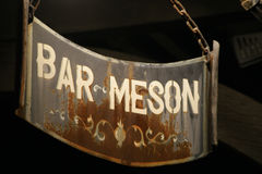 Sign of bar tavern of iron rusty and hung with chains 9 Royalty Free Stock Photo