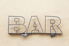 Sign bar in town Stock Photography