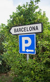 Sign in Barcelona in the trees. Sign Barcelona and Parking in the trees Royalty Free Stock Photos