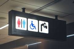 Sign bathrooms for men, women and the disabled. Stock Photos