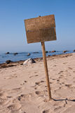 Sign at beach. One blank wooden sign at empty beach Stock Photo