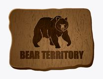 Sign for bear territory. Wooden board with bear illustration Royalty Free Illustration