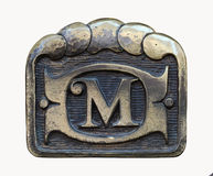 Sign М. Beautiful metal sign the letter M, handmade Stock Photography