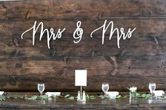 A sign behind the head table at a lesbian wedding. royalty free stock image