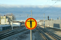 Sign Beware of trespassing at train station Stock Images