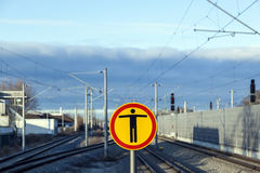 Sign Beware of trespassing at train station Stock Image