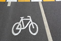 Sign of bicycle. Designation of cycling on a strip of asphalt on the road Stock Photography
