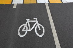 Sign of bicycle. Designation of cycling on a strip of asphalt on the road Stock Images