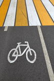 Sign of bicycle. Designation of cycling on a strip of asphalt on the road Royalty Free Stock Image