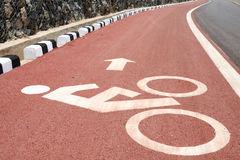 Sign of bicycle lane with arrow direction. Stock Images