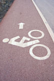 Sign of bicycle lane beside the road Stock Photography