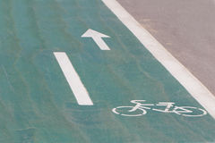 Sign on a bicycle path. Green Sign on a bicycle path stock photos