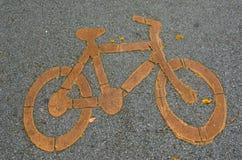 Sign of bicycle way on the asphalt. Bicycle sign on the asphalt mean who ride bicycle must go this way Stock Photos