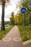 Sign of the bicycle zone. On the paved path Royalty Free Stock Photography
