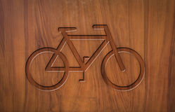Sign bicycles on wood Stock Photo