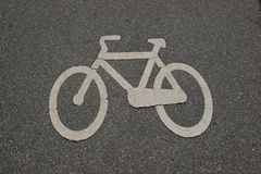 Sign of a bike. At a bicycle lane royalty free stock image