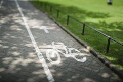 Sign on bike lane Stock Image