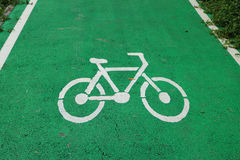 Sign of bike lane in the park. Detail sign of bike lane in the park Royalty Free Stock Photos