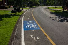 Sign of bike lane in the park Royalty Free Stock Photography