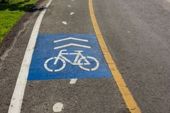 Sign of bike lane in the park. Sign of bike lane in the public park Royalty Free Stock Photo