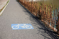 Sign of bike road. Sign of a bike road close to a lake Royalty Free Stock Images
