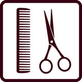 Sign with black scissors and comb Stock Photo