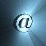 At sign blue halo light flare Royalty Free Stock Photography