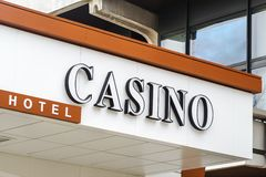 Sign board Casino above the entrance to the hotel, white letters with black border on a white background royalty free stock image