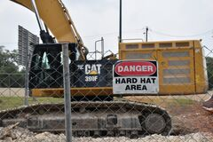 Free Sign Board : Danger Hard Hat Area, Yellow Color Caterpillar Cat JCB Digger In Background Stock Image - 183876031
