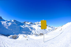 Sign board at High mountains under snow Royalty Free Stock Photography