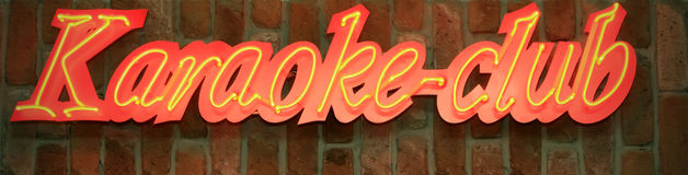 Sign board of karaoke club. Red and yellow sign board of karaoke club Stock Photography