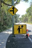 Sign board of man holding street sign for traffic changes stock image