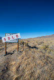 Sign board saying a farm land has been sold in the desert of nev Royalty Free Stock Images