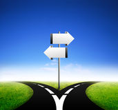 Sign board standing at a crossroads Royalty Free Stock Images