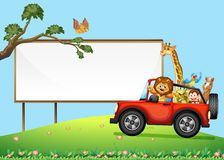 A Sign Board and Wild Animals Royalty Free Stock Photos