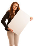 Sign board. Woman holding big white blank card. Positive emotion. Al portrait of happy girl with long hair Stock Photos
