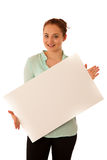 Sign board. Woman holding big white blank card. Positive emotion. Al portrait of happy girl with long hair Stock Photo