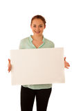 Sign board. Woman holding big white blank card. Positive emotion Royalty Free Stock Photography