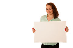 Sign board. Woman holding big white blank card. Positive emotion. Al portrait of happy girl with long hair Royalty Free Stock Image
