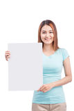 Sign board. Young asian woman holding big white card isolated on Stock Photo