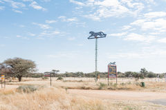 Sign boards for the Okonjima Africat reserve. OKAHANDJA, NAMIBIA - JUNE 19, 2017:  Sign boards for the Okonjima Africat reserve between Okahandja and Otjiwarongo Royalty Free Stock Photo