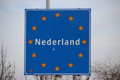 Sign at the border of the Netherlands with european stars and name Nederland in it. Sign at the border of the Netherlands with european stars and name Nederland stock photos