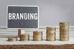 Sign Branding with growth coin stacks Stock Photos
