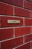 Sign brick wall Stock Image