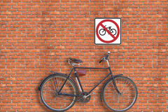 Sign. Brick wall and bicycle Royalty Free Stock Photos