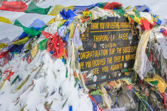 The sign with buddhist  prayer flags at Thorong La mountain in Nepal Stock Images