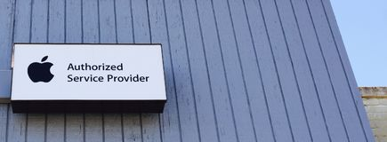 Apple Authorized Service Provider. A sign on a building lets owners of MacBook`s, iPhones and iPads know that this location is an authorized services provider Stock Image